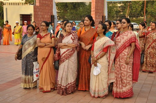 Middle aged house wives wearing Sari