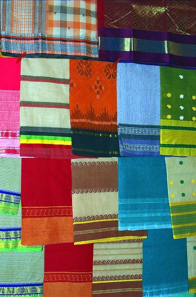 Several Bengal cotton and silk sarees on display