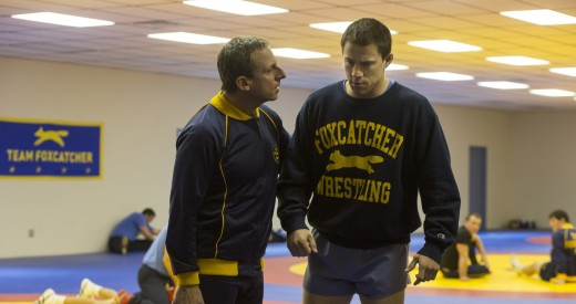 """John du Pont (Steve Carrell) gives Mark Schultz (Channing Tatum) a pep talk in their gym in a scene from """"Foxcatcher""""."""