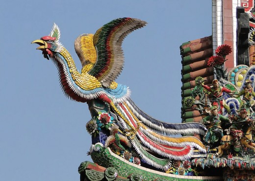 A Fenghuang or Chinese phoenix on the roof of the Main Hall of the Mengjia Longshan Temple in Taipei, Taiwan