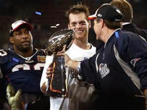 Tom Brady and Bill Belichek enjoying their 4th Lombardi trophy together.
