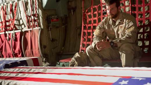 """Chris Kyle (Bradley Cooper) accompanies the coffins of his fallen comrades back to the U.S. in a scene from """"American Sniper""""."""