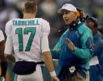 Joe Philbin and Ryan Tannehill talk over game strategy.