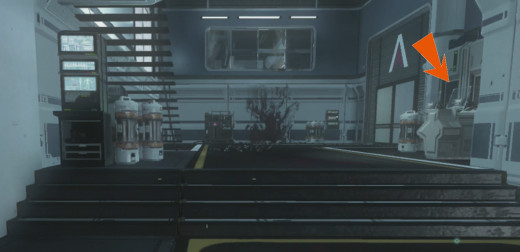 The Terminal is indicated with an Orange Arrow. It is across from the stairs that lead to the Exo Reload Upgrade.