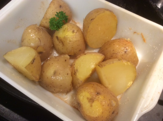 Parboiled and baked yellow potatoes  with olive oil, Italian seasonings and Asagio cheese -- or you can just boil them.