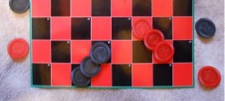 How To Play A New Game Slides And Ladders On A Checkerboard