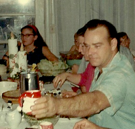 Dad at Christmas 1967, with me in the background.