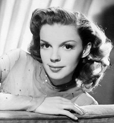 I can live without money, but I cannot live without love. - Judy Garland