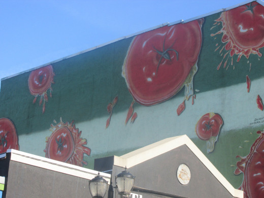 A mural of tomatoes going splat as in the tomato festival fight.