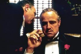 """A scene from the movie, The Godfather.  Featured: Godfather of the Corleone Crime Family, Don Vito Corleone (seated), in conference with an Italian undertaker called Bonacera, a desperate man who needs a """"favor"""" from his """"friend."""""""