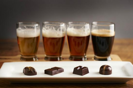 a beer flight paired with different types of chocolate