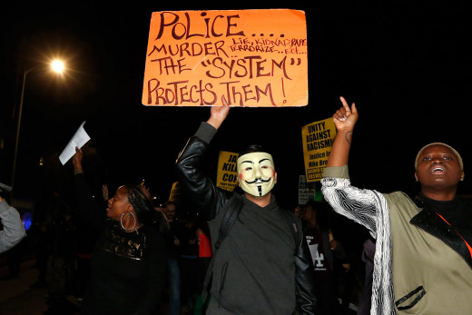 Protestors in L.A. repeat the message in a demonstration in Los Angeles following the grand jury's refusal to indict Officer Wilson in the shooting of Michael Brown.