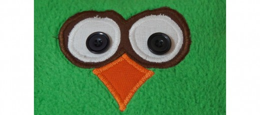 Appliqué owl face cushion