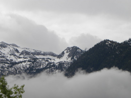 Clouds both above and below this mountain create a beautiful symmetry.