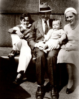 Stan Lee, 9, (L) with his parents Jack and Celia Lieber, and younger brother, Larry.