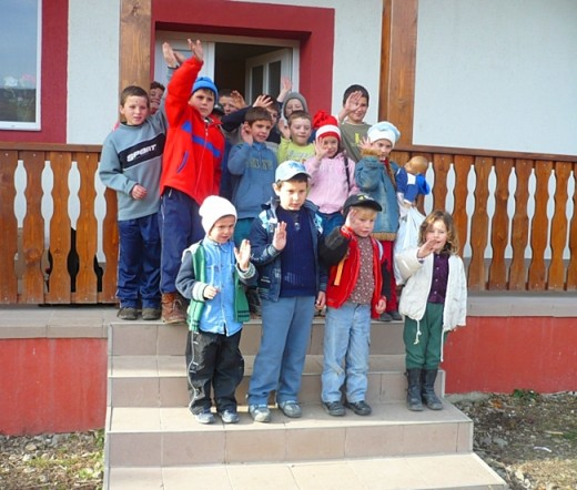 Children in front of their school