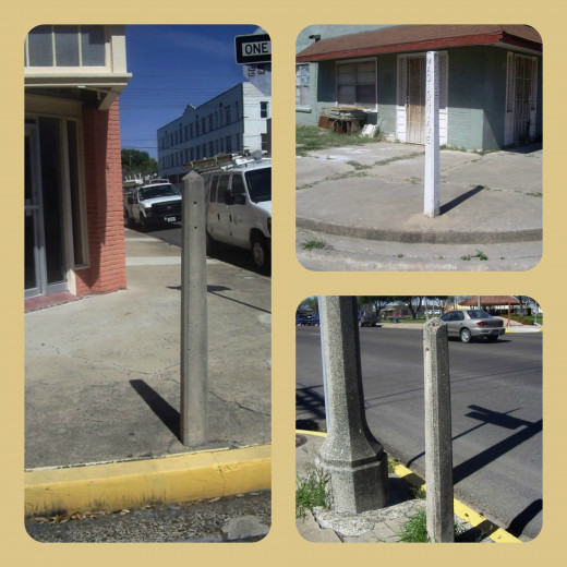 Three of the four concrete posts downtown Harlingen, Texas