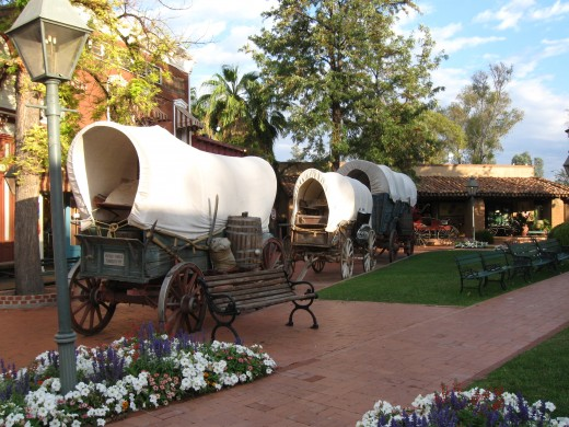 Antique covered wagons on Main Street of Trail Dust Town in Tucson, AZ