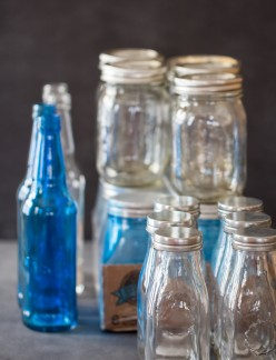 The glassware that I collected for my flower vases including clear and blue mason jars.