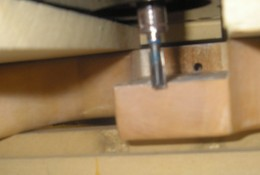 Here you see the router bit and guide boards I clamped down.