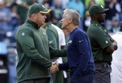 Hi my name is Mike McCarthy and I will gift wrap this game to you.  Nice to meet you Mike.  I'm Pete Carroll and I will take this game and gift wrap the next to the Patriots.  Pay it Forward!