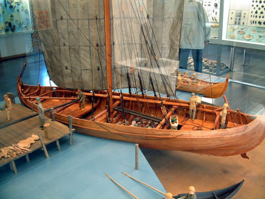 Model knarr seen as at a dockside in this ship museum, part of a karve can be seen behind in the middle of the picture