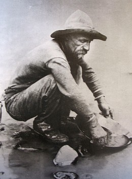 Forty-niner panning for gold in California, c. 1850.