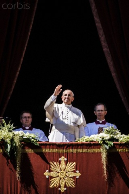 Pope Francis waves at followers
