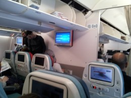 Aboard the B777-300ER The cabin has a calming and soothing ambience despite its vibrant seat colours.
