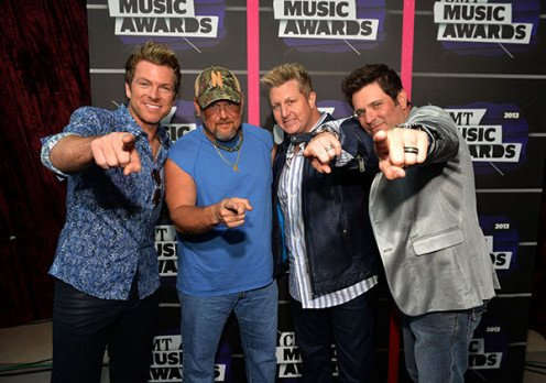 Larry visits with Rascal Flatts