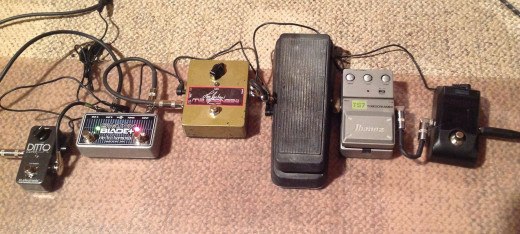 Left to right: TC Electronics Ditto looper, Electro-Harmonix Switchblade A/B box, Lee Jackson Mr. Springgy Reverb pedal, Dunlop Crybaby wah, Ibanez TS7 Tubescreamer, and Korg Pitchblack chromatic tuner.