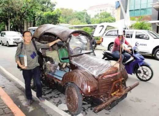 UP Prof. BENJAMIN MANGUBAT with his solar green car  (Photo Source: Joan Bondoc @http://newsinfo.inquirer.net/)