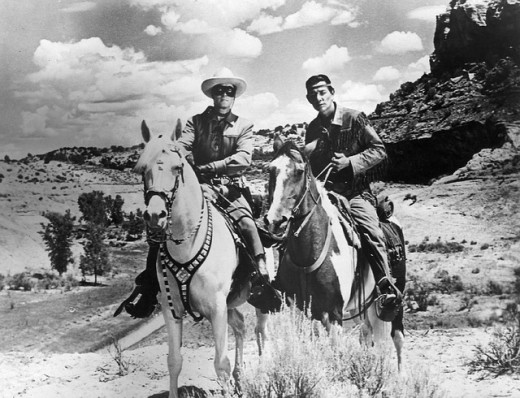 Clayton Moore and Jay Silverheels as The Lone Ranger and Tonto. Western.