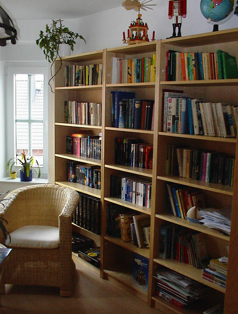 This is a nice, cozy home library. A home library does not make a person a book hoarder: The inability to give up the books once they come into the house does.