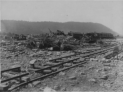 Wrecked Pullman cars and engines c. 1889