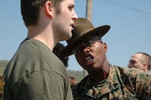 A drill instructor yells at a Marine recruit. Recruits get yelled-at most of the six-weeks they are in boot camp. I was yelled-at a lot when I was  kid. That's why I feared the Marines.