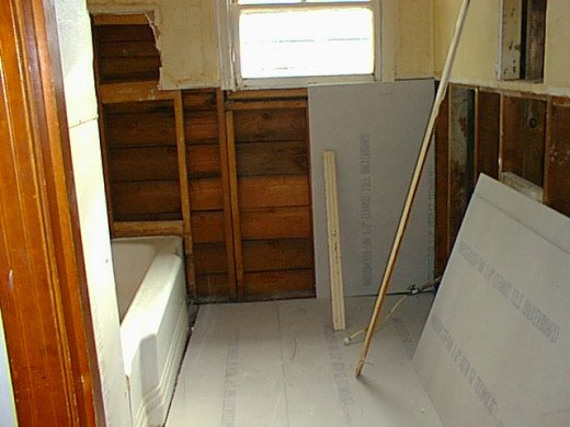 The wallboard and floors were replaced with hardy backer moisture-resistant material.