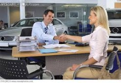 Salesman sealing the deal with happy customer