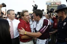 Crimson Tide head coach, Nick Saban, left, shakes hands with then-Texas A&M's Johnny Manziel