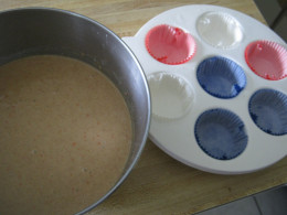 The cupcake mix and microwave dish with cupcake baking papers