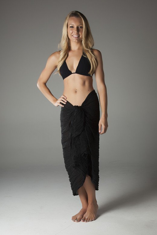 Sarong worn tied at waist.