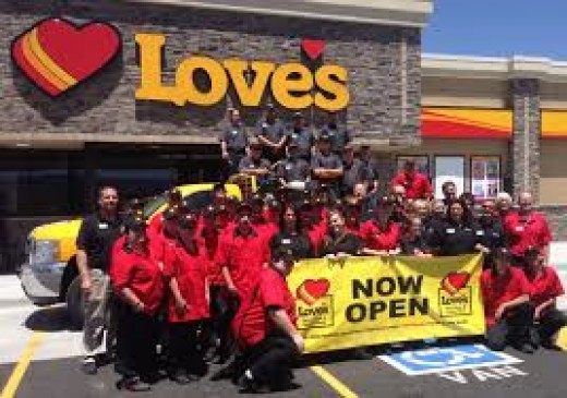 These employees are celebrating the grand opening of Loves truck stop