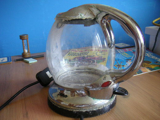 Kettle ruined by limescale. Use vinegar or lemon juice to remove it.