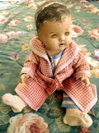 My mother's favorite well worn Dionne Quintuplet doll