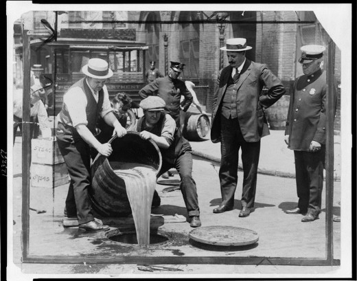 Liquor being poured into the sewer, circa 1920s