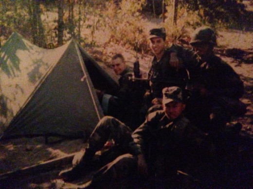 My brother Kenneth (next to the tent) while in the Army.