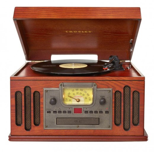A record player is a stand alone unit, complete with built-in speakers.
