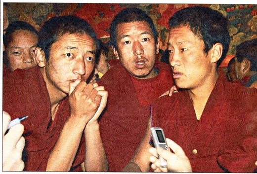 This recent photo shows Tibetan monks risking their lives to beg for help from Western media.