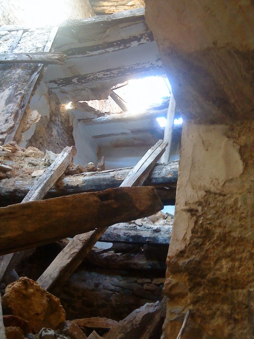 Beams and collapsed bedroom