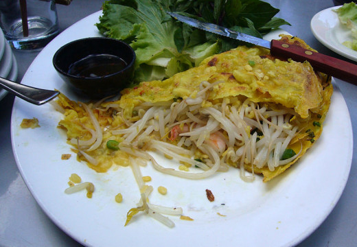 Vietnamese Banh xeo is a crisp and lacy pancake (crepe) that is fried and used as a wrapper for fillings of stir fried prawns, pork and vegetables